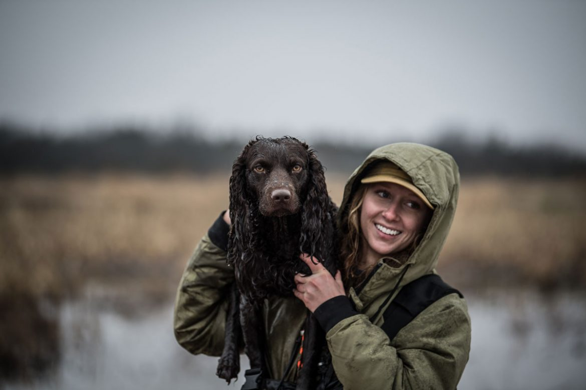 Hannah Criscoe of Whistling Wings Kennels and her Boykin spaniel Wheeler